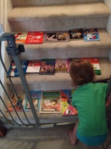 D with books on stairs